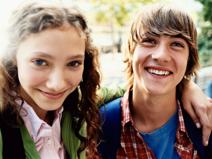 Teenage boy and girl smiling